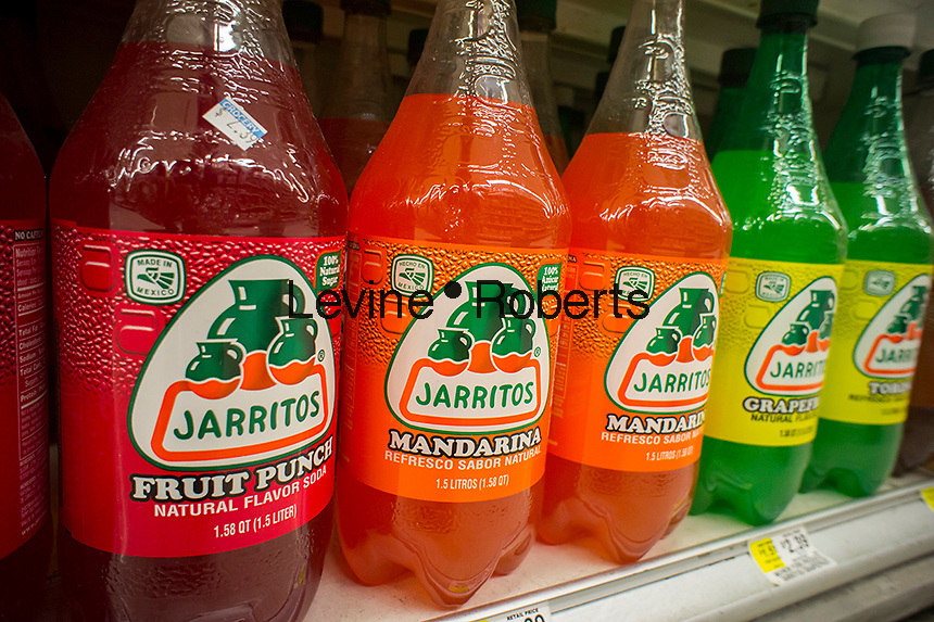 Bottles of Jarritos, a Mexican soda, in a supermarket in New York on Tuesday, July 9, 2013. The soda, whose popularity with Hispanic groups has increased its US sales, is becoming widely available in supermarkets because of its appeal to non-Hispanic customers. (© Richard B. Levine)