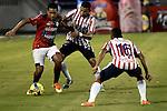 Atlético Junior y Cúcuta Deportivo empataron 1 - 1 en la novena jornada del Torneo Clausura Colombiano 2013 / Javier Araujo (l) sostiene el balón ante la marca de dos rivales.
