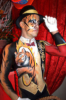 Circus bodypainting and photoshooting with model Stefan as ringmaster / Tiger in the Rattenfaengerhalle. Hamelin on February 7, 2015 - Body Paint Artist: Jörg Düsterwald