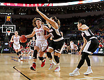 SIOUX FALLS, SD: MARCH 5: 	Allison Arens #10 from the University of South Dakota drives to the basket against Abi Lujan #21 from Nebraska Omaha during the Summit League Basketball Championship on March 5, 2017 at the Denny Sanford Premier Center in Sioux Falls, SD. (Photo by Dave Eggen/Inertia)