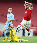 Arsenal's Donyell Malen tussles with Manchester City's Daniel Grimshaw during the premier league 2 match at the Emirates Stadium, London. Picture date 21st August 2017. Picture credit should read: David Klein/Sportimage