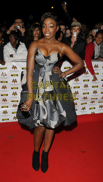 ESTELLE.MOBO Awards at Wembley Arena, London, England. .October 15th, 2008 .MOBOS music of black origin full length grey gray black strapless dress ankle boots hand on hip camouflage clutch bag.CAP/CAN.©Can Nguyen/Capital Pictures.
