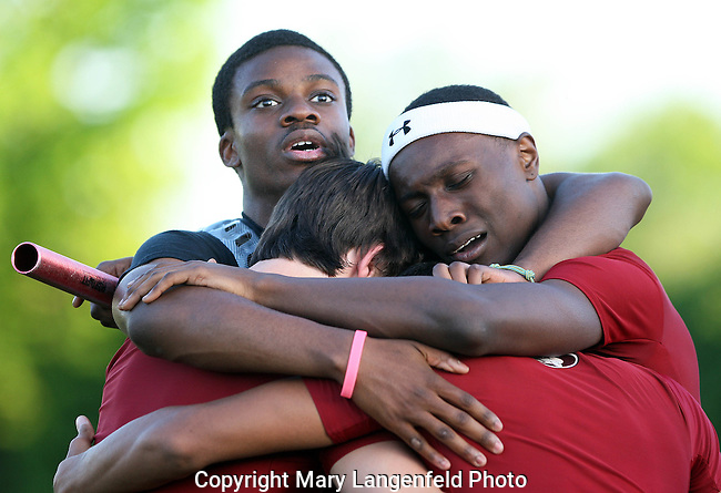 Nnambi Okoli celebrates Middleton's second place win in the 4x100 Meter relay.  Group hug clockwise from top: Nnambi, Ernest Winters, Trevon Turner, and Noah Meeteer.<br /> Nambi did not participate in the relay.