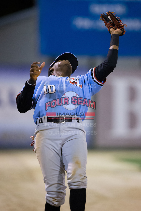 Hickory Crawdads third baseman Ti'Quan Forbes (10) reaches back to catch a fly ball in foul territory during the game against the Kannapolis Intimidators at Kannapolis Intimidators Stadium on April 9, 2016 in Kannapolis, North Carolina.  The Crawdads defeated the Intimidators 6-1 in 10 innings.  (Brian Westerholt/Four Seam Images)