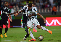 MEDELLIN - COLOMBIA -20-05-2015: Luis C Ruiz (Der.) jugador de Atletico Nacional disputa el balón con German Mera (Izq.) jugador del Deportivo Cali durante partido de ida entre Atletico Nacional y Deportivo Cali por los cuartos de final de la Liga Aguila I 2015 en el estadio Atanasio Girardot de la ciudad de Medellin. / Luis C Ruiz (R) player of Atletico Nacional fights for the ball with German Mera (L) playerof Deportivo Cali during a match between Atletico Nacional and Deportivo Cali for the first leg of the quarterfinals of the Liga Aguila I 2015 at the Atanasio Girardot stadium in Medellin city. Photos: VizzorImage  / Leon Monsalve / Str.