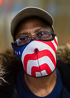 NEW YORK, NY - April 13:  A man wears a face mask with the U.S. flag during a rainy day on April 13, 2020. in New York, United States. The global economy is facing the worst collapse since the WWII, while COVID-19  pandemic has now killed more than 22,000 people in the United States and at least 1,864,629 people died world wide.  (Photo by Eduardo MunozAlvarez/VIEWpress)