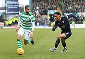 17th March 2019, Dens Park, Dundee, Scotland; Ladbrokes Premiership football, Dundee versus Celtic; Jeremy Toljan of Celtic controls the ball away from Nathan Ralph of Dundee