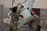 Mcc0053988 . Daily Telegraph<br /> <br /> DT News<br /> <br /> Sig Hannah Roberts takes down the Task Force Helmand HQ sign with some help from a colleague after the official handover ceremony which took place in Camp Bastion of Task Force Helmand to Nato command signalling the end of British combat operations in Afghanistan .<br /> <br /> Helmand 30 March 2014