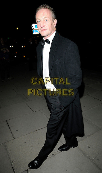 "RICHARD DUNWOODY.At the ""February Feel Good"" Fundraising Event, Sheraton Park Lane hotel, Piccadilly, London, England, UK, .February 5th 2010..full length black tuxedo coat hands in pockets bow tie tux .CAP/CAN.©Can Nguyen/Capital Pictures"