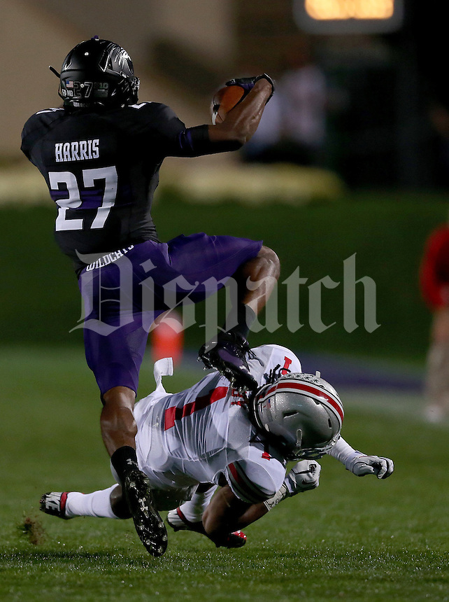 Ohio State Buckeyes cornerback Bradley Roby (1) gets low on Northwestern Wildcats running back Mike Panico (27) during the first half of the NCAA football game between Ohio State and Northwestern at Ryan Field in Evanston, Illinois on Saturday, October 5, 2013. (Columbus Dispatch photo by Jonathan Quilter)