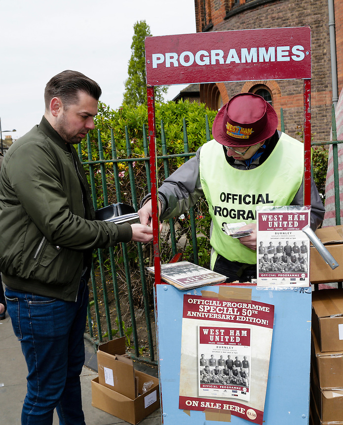 A fan buys a programme outside the Bolyen Ground, home of West Ham United<br /> <br /> Photographer Craig Mercer/CameraSport<br /> <br /> Football - Barclays Premiership - West Ham United v Burnley - Saturday 2nd May 2015 - Boleyn Ground - London<br /> <br /> &copy; CameraSport - 43 Linden Ave. Countesthorpe. Leicester. England. LE8 5PG - Tel: +44 (0) 116 277 4147 - admin@camerasport.com - www.camerasport.com