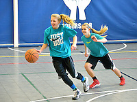 STAFF PHOTO BEN GOFF  @NWABenGoff -- 12/29/14 Kiera Mahmens, 13, left, and Cali Cook, 12, of Rogers play in a pickup basketball game at the Rogers Activity Center in Rogers on Monday Dec. 29, 2014.