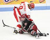 Jenn Wakefield (BU - 9), Sarah Edney (Harvard - 3) - The Boston University Terriers defeated the Harvard University Crimson 5-2 on Monday, January 31, 2012, in the opening round of the 2012 Women's Beanpot at Walter Brown Arena in Boston, Massachusetts.