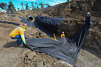 March 15, 2019. Vista, CA. USA|  Construction worker Jose Bautista, left, and others lie filter fabrics in a drainage ditch while working on future apartments at 1309 N. Santa Fe in Vista. | Photos by Jamie Scott Lytle. Copyright.