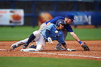 Charlotte Stone Crabs second baseman Kean Wong (4) slides in as third baseman Mitch Nay (28) can not come up with the throw during a game against the Dunedin Blue Jays on July 26, 2015 at Charlotte Sports Park in Port Charlotte, Florida.  Charlotte defeated Dunedin 2-1 in ten innings.  (Mike Janes/Four Seam Images)
