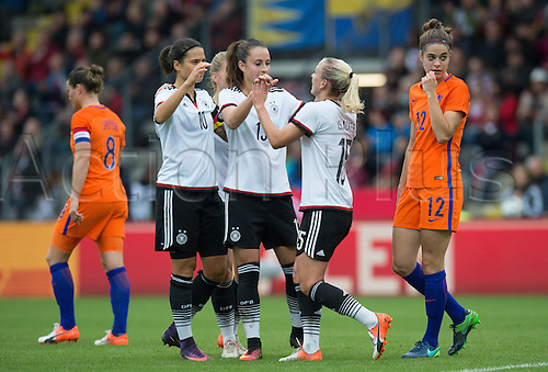 25.10.2016. Aeln, Germany.  Germany's Dzsenifer Marozsan, Sara Daebritz and goal-scorer Mandy Islacker celebrate their goal for 1-0 during the women's international football match between Germany and the Netherlands in the Scholz Arena in Aalen, Germany, 25 October 2016.