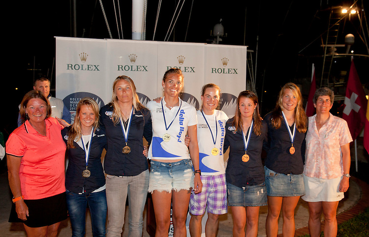(L to R).2nd: 118, Fleet: 470-Women, Crew: Hannah mills, Saskia Clark, Country: GBR.1st: 11, Fleet: 470-Women, Crew: Lisa Westerhof, Lobke Berkhout, Country: NED.3rd: 855, Fleet: 470-Women, Crew: Sophie Weguelin, Sophie Ainsworth, Country: GBR