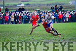 St Marys Denis Daly is dragged down by Watervilles Kevin O'Dwyer in the South Kerry Championship Final in Portmagee on St Stephens Day.
