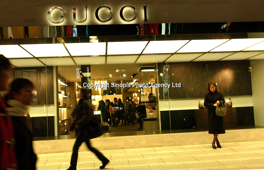 People shop at the French designer Gucci fashion designer goods in Shinjuku, Tokyo. Despite the recession the big designers remain popular in Tokyo.. ...