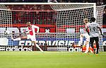 Nederland, Amsterdam, 3 november 2012.Eredivisie.Seizoen 2012-2013.Ajax-Vitesse (0-2).Stefano Denswil (l.) van Ajax kan de bal van Wilfried Bony (r.) van Vitesse niet meer keren, 0-1.