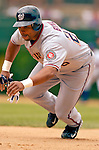 1 July 2005: Marlon Byrd, outfielder for the Washington Nationals, dives back to first base in a game against the Chicago Cubs. The visiting Nationals defeated the Cubs 4-3 at Wrigley Field in Chicago.  Mandatory Photo Credit: Ed Wolfstein