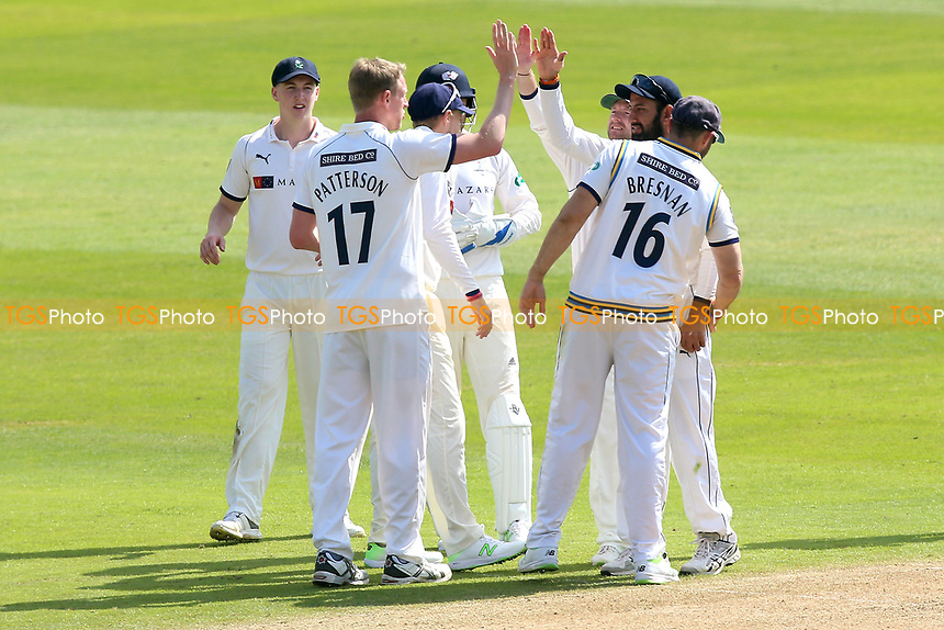 Steven Patterson of Yorkshire celebrates with his team mates after taking the wicket of Ravi Bopara during Essex CCC vs Yorkshire CCC, Specsavers County Championship Division 1 Cricket at The Cloudfm County Ground on 4th May 2018