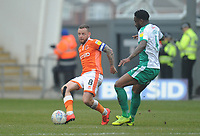 Blackpool's Jay Spearing under pressure from Plymouth Argyle's Yann Songo'o<br /> <br /> Photographer Kevin Barnes/CameraSport<br /> <br /> The EFL Sky Bet League One - Blackpool v Plymouth Argyle - Saturday 30th March 2019 - Bloomfield Road - Blackpool<br /> <br /> World Copyright © 2019 CameraSport. All rights reserved. 43 Linden Ave. Countesthorpe. Leicester. England. LE8 5PG - Tel: +44 (0) 116 277 4147 - admin@camerasport.com - www.camerasport.com
