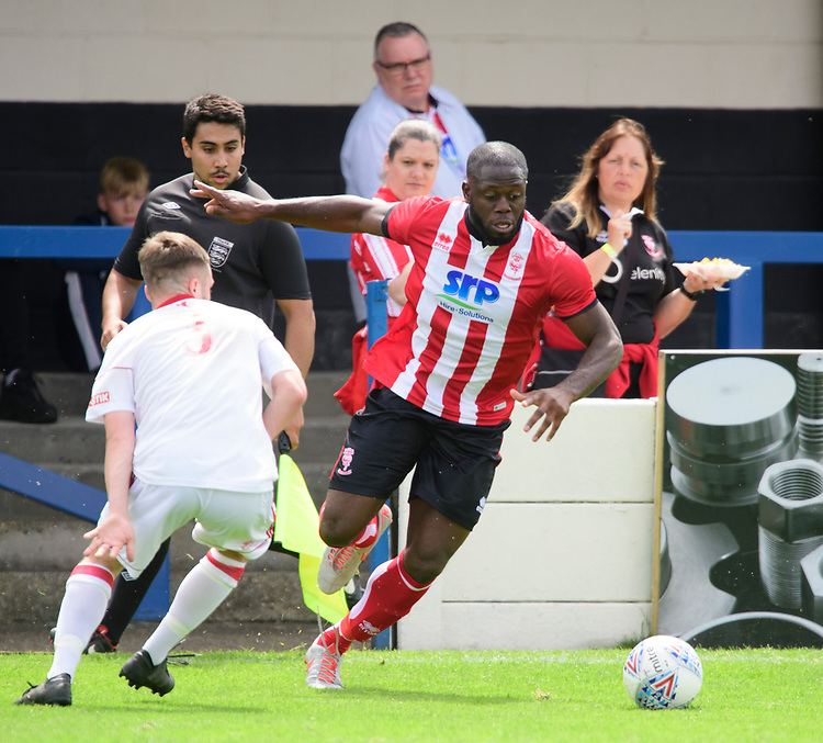 Lincoln City's John Akinde vies for possession with Lincoln United's trialist<br /> <br /> Photographer Chris Vaughan/CameraSport<br /> <br /> Football Pre-Season Friendly (Community Festival of Lincolnshire) - Lincoln City v Lincoln United - Saturday 6th July 2019 - The Martin & Co Arena - Gainsborough<br /> <br /> World Copyright © 2018 CameraSport. All rights reserved. 43 Linden Ave. Countesthorpe. Leicester. England. LE8 5PG - Tel: +44 (0) 116 277 4147 - admin@camerasport.com - www.camerasport.com