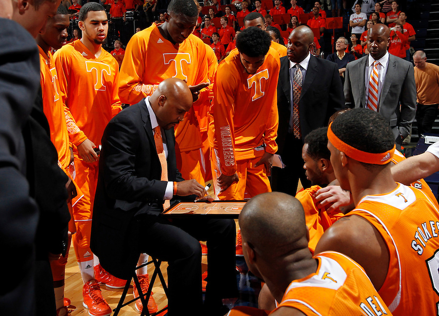 Tennessee head coach Cuonzo Martin in the huddle during the game Wednesday in Charlottesville, VA. Virginia defeated Tennessee 46-38.