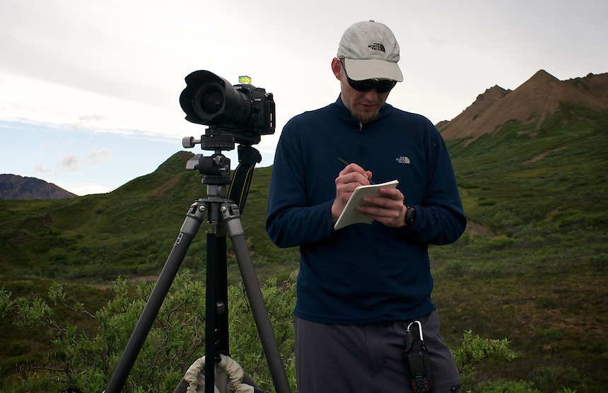 June 26, 2011, Geologist and Photographer Ron Karpilo repeating a photograph taken in 1916 by U.S. Geological Survey geologist Stephen R. Capps near Polycrome Pass, Denali National Park and Preserve, Alaska, United States.