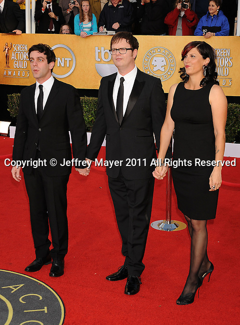 LOS ANGELES, CA - January 30: BJ Novak and Rainn Wilson and wife writer Holiday Reinhorn arrive at the 17th Annual Screen Actors Guild Awards held at The Shrine Auditorium on January 30, 2011 in Los Angeles, California.
