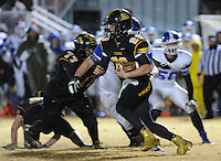NWA Democrat-Gazette/ANDY SHUPE<br /> Blake Faulk (20) of Prairie Grove carries the ball through the Star City defense Friday, Nov. 27, 2015, during the first half of play at Tiger Stadium in Prairie Grove. Visit nwadg.com/photos to see more photographs from the game.