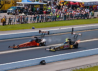 Jun 17, 2018; Bristol, TN, USA; NHRA top fuel driver Mike Salinas (far) defeats Leah Pritchett during the Thunder Valley Nationals at Bristol Dragway. Mandatory Credit: Mark J. Rebilas-USA TODAY Sports