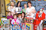 TOYS: Kellihers Mace presented toys to the children's ward for Christmas, from left: Julie O'Sullivan, Sinead Coffey (nurse) holding Matthew Quilter, Alisha Eainton, Barry Heneghan, Dagmar Kolesaroea, Carly Stack, Mary Bonn (childcare nurse), Rosemarie Pierce (senior nurse) holding Daniel Corkery.