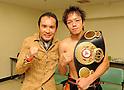 (R-L) Tomonobu Shimizu (JPN), Tsurutaro Kataoka, AUGUST 31, 2011 - Boxing : Tomonobu Shimizu of Japan poses with Tsurutaro Kataoka after winning the WBA super flyweight title bout at Nippon Budokan in Tokyo, Japan. (Photo by Mikio Nakai/AFLO)