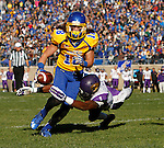 BROOKINGS, SD - OCTOBER 24:  Connor Landberg #18 from South Dakota State steps out of the grasp of Deiondre' Hall #1 from University of Northern Iowa en route to a touchdown in the third quarter of their game Saturday afternoon at Coughlin Alumni Stadium in Brookings. (Photo by Dave Eggen/Inertia)