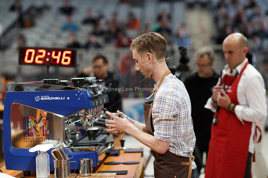 MELBOURNE, AUSTRALIA - MAY 23 Oskar Alvérus from Sweden in action on day one of the 2013 World Barista Championship at the Melbourne Showgrounds, Australia. Photo Sydney Low / syd-low.com