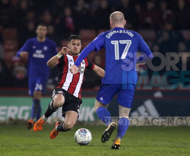 George Baldock of Sheffield Utd tackles Aron Gunnarsson of Cardiff City during the Championship match at Bramall Lane Stadium, Sheffield. Picture date 02nd April, 2018. Picture credit should read: Simon Bellis/Sportimage