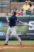 Mitchell Kranson (9) of the Elizabethton Twins follows through on his swing against the Pulaski Yankees at Calfee Park on July 25, 2016 in Pulaski, Virginia.  The Twins defeated the Yankees 6-1.  (Brian Westerholt/Four Seam Images)