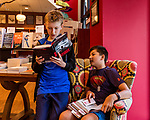 July 26, 2017. Raleigh, North Carolina.<br /> <br /> (left to right) Collin Aherne and Noah deVries check out Alan Gratz's new book &quot;Refugee&quot; before the signing event begins. <br /> <br /> Author Alan Gratz spoke about and signed his new book &quot;Refugee&quot; at Quail Ridge Books. The young adult fiction novel contrasts the stories of three refugees from different time periods, a Jewish boy in 1930's Germany , a Cuban girl in 1994 and a Syrian boy in 2015.