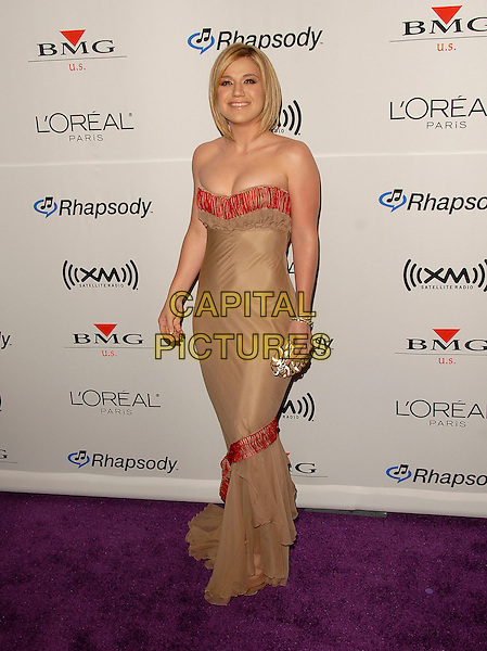 KELLY CLARKSON.Attends The Annual Clive Davis Pre-Grammy Extravaganza held at The Beverly Hilton Hotel in Beverly Hills, California, USA, February 7, 2006..full length strapless tan beige dress straight blonde hair layers ruffles red orange trim.Ref: DVS.www.capitalpictures.com.sales@capitalpictures.com.©Debbie Van Story/Capital Pictures