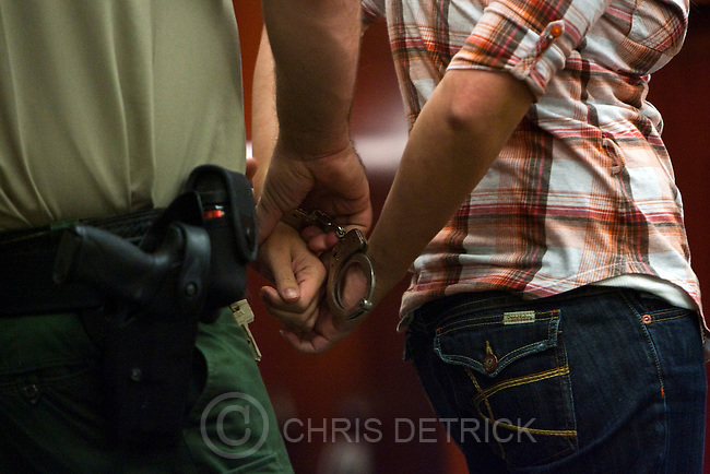 Chris Detrick  |  The Salt Lake Tribune .A defendant is handcuffed by bailiff Adam Shelley during drug court with Judge Deno Himonas at the Matheson Courthouse Thursday October 21, 2010.