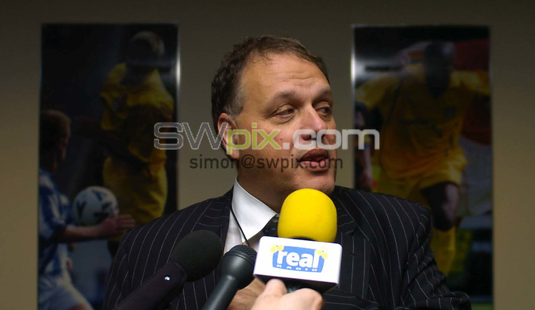 Pix: Simon Wilkinson/SWpix.com Football. Leeds United relegation story. 04/05/2004..COPYRIGHT PICTURE>>SIMON WILKINSON>>01943 608782>>..Gerald Krasner faces the press alongside  shadowed by a picture of Alan Smith after a board meeting at Elland Road today.