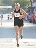 Jacob Riley, 26, of Rochester, MI (Bib No. 8) legs out the final stretch of Northport's annual Cow Harbor 10-kilometer run on Saturday, September 19, 2015. He finished in second place with a time of  29:27.42.<br /> <br /> James Escher