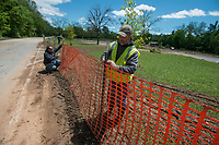NWA Democrat-Gazette/ANTHONY REYES @NWATONYR<br /> Mike Kolke (right) and James Bassham, both with the Springdale Parks and Recreation department, put up safety fencing Monday, May 1, 2017 by the Lake Springdale Trailhead in Springdale. The trailhead is closed after recent flooding destroyed the parking lot.