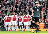 Burnley's Chris Wood cuts a frustrated figure as Arsenal celebrate going 1-0 ahead<br /> <br /> Photographer David Shipman/CameraSport<br /> <br /> The Premier League - Arsenal v Burnley - Saturday 22nd December 2018 - The Emirates - London<br /> <br /> World Copyright © 2018 CameraSport. All rights reserved. 43 Linden Ave. Countesthorpe. Leicester. England. LE8 5PG - Tel: +44 (0) 116 277 4147 - admin@camerasport.com - www.camerasport.com