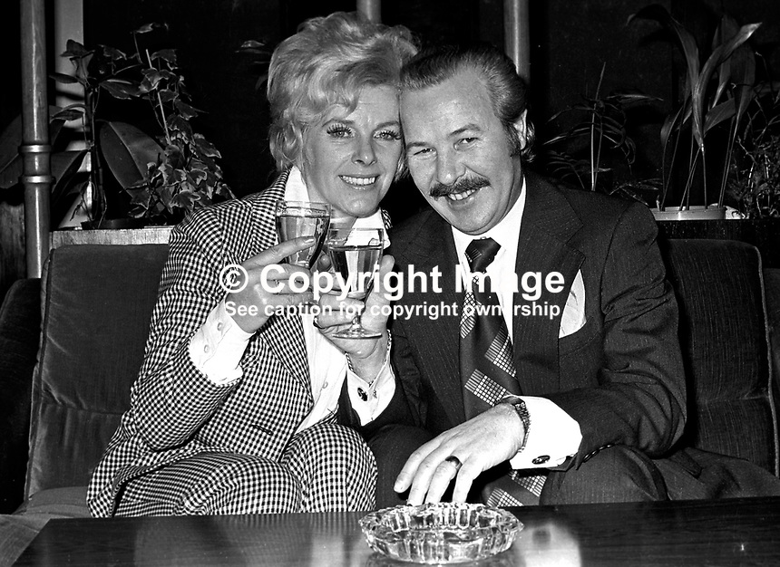Harper Brown, manager, Europe Hotel, Belfast, N Ireland, has a celebratory drink with his wife, Sally, to mark the occasion of him being awarded in the UK New Year's Honours' List an MBE for services to tourism i.e. keeping his much-bombed hotel open throughout the N Ireland Troubles. 197501050016b..Copyright Image from Victor Patterson, 54 Dorchester Park, Belfast, UK, BT9 6RJ..Tel: +44 28 9066 1296.Mob: +44 7802 353836.Voicemail +44 20 8816 7153.Skype: victorpattersonbelfast.Email: victorpatterson@me.com.Email: victorpatterson@ireland.com (back-up)..IMPORTANT: If you wish to use this image or any other of my images please go to www.victorpatterson.com and click on the Terms & Conditions. Then contact me by email or phone with the reference number(s) of the image(s) concerned.
