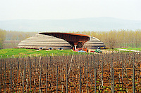 The Disznoko winery in Tokaj: the famous tractor garage built in the very typical Hungarian organic style, with vineyards. The Disznók? winery is owned by AXA Millesimes, a French insurance company. Disznoko means pig's head since a big rock in the vineyard supposedly looks like that. The new winery is impressive and a vast amount of money has been invested. Credit Per Karlsson BKWine.com