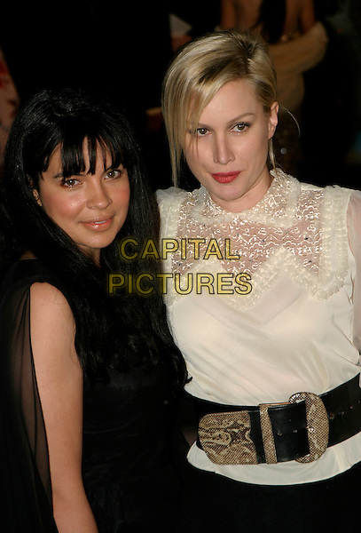 """ALICE EVANS & GUEST.""""The Chronicles of Narnia: The Lion, The Witch & The Wardrobe"""" - world premiere at the Royal Albert Hall, London, UK..December 7th, 2005.Ref: AH.half length white sheer top wide belt red lipstick.www.capitalpictures.com.sales@capitalpictures.com.©Capital Pictures"""