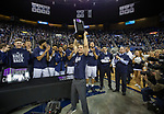 Nevada head coach Eric Musselman hols up the trophy after their win over Colorado State for the Mountain West Championship in a NCAA college basketball game in Reno, Nev., Sunday, Feb. 25, 2018. (AP Photo/Tom R. Smedes)